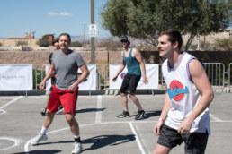 NAI Vegas team playing defense in Charity Basketball Tournament