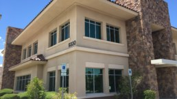 Tan building with rock accents sold as Las Vegas commercial real estate