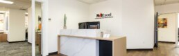 front desk of NAI Excel building in St George