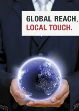 hands holding a globe with text that says,